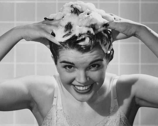 Young woman shampooing her hair --- Image by © SuperStock/SuperStock/Corbis